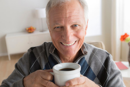 60 64 years: Senior man with cup of coffee