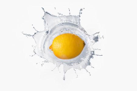 refreshed: Lemon splashing in liquid