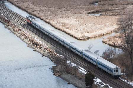 pastoral scenery: Aerial view of train travelling though countryside