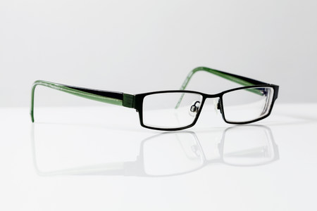 mirroring: Spectacles on table