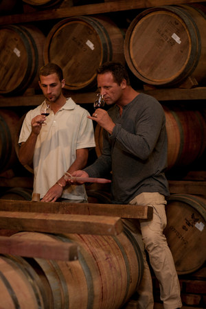 lit image: Sampling wine in barrels