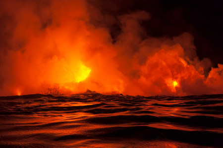 erupting: Lava flow into sea at night,Kilauea volcano,Hawaii