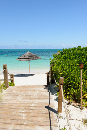 Boardwalk and parasol,Grace Bay,Providenciales,Turks and Caicos,Caribbean