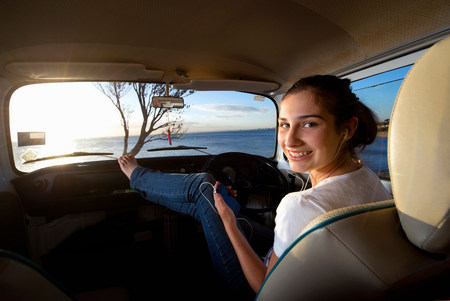 liberating: Young woman in camper van with feet up LANG_EVOIMAGES