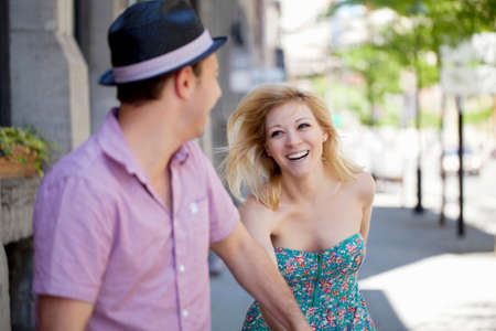 Young couple on street,woman smiling