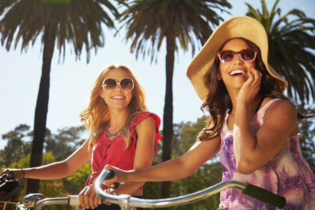 impulsive: Women on bicycle laughing