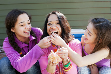 silliness: Two sisters feeding mother cupcake