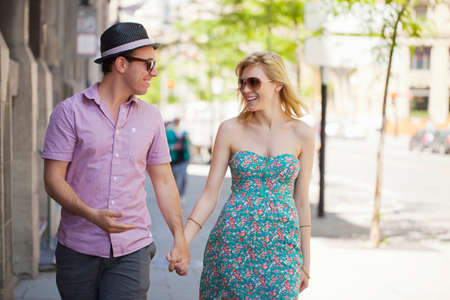 Young couple holding hands on street