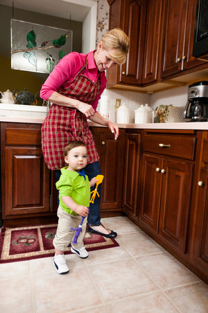 casual clothing 12 year old: Young male toddler and grandmother in kitchen LANG_EVOIMAGES