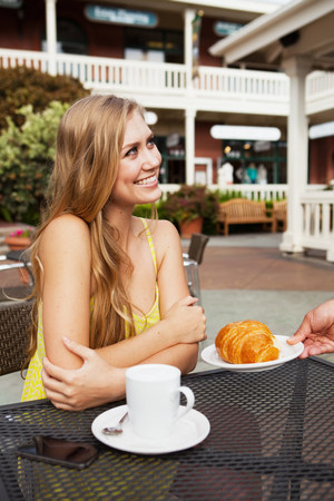 Woman being served croissant LANG_EVOIMAGES