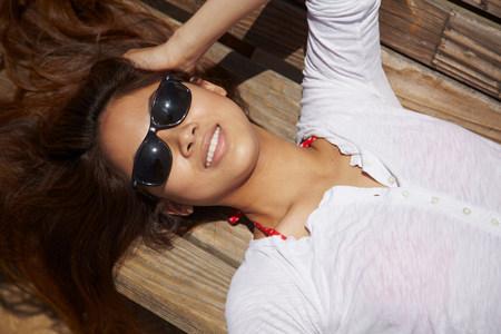 lies down: Young woman sunbathing,Palos Verdes,California,USA