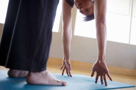 Mature male practicing yoga indoors