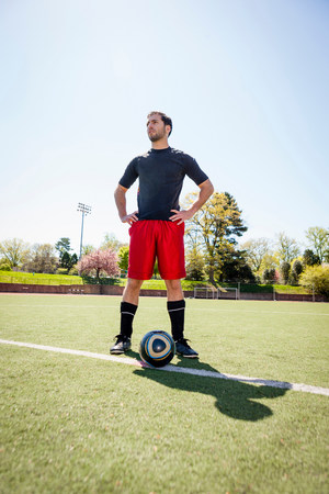 species living: Soccer player waiting to start play