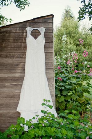 coathangers: Wedding dress hanging on garden shed