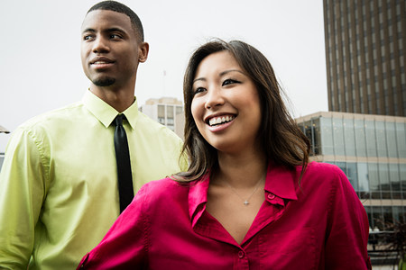 afro caribbean ethnicity: Young business colleagues smiling LANG_EVOIMAGES