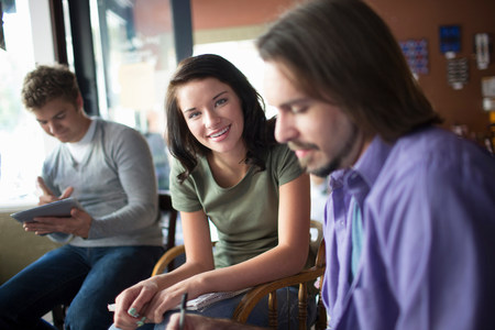 tomes: Group of people studying together in coffee shop