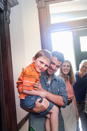 passageways: Father holding son in hallway,smiling
