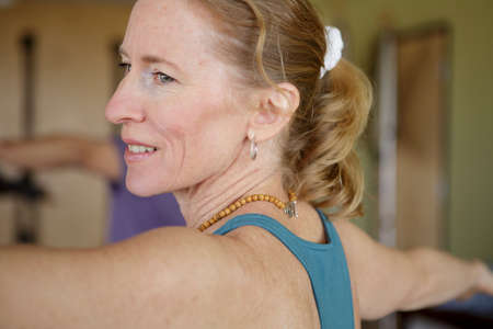 Close up of mature female exercising in class LANG_EVOIMAGES