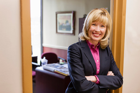 returning: Portrait of mature female outside home office