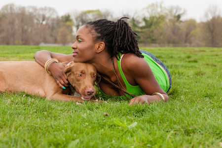 hungarian pointer: Young woman and her dog lying on grass