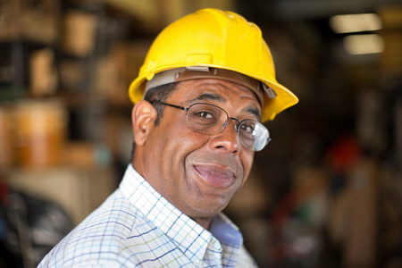 american field service: Close up portrait of man in stockroom LANG_EVOIMAGES