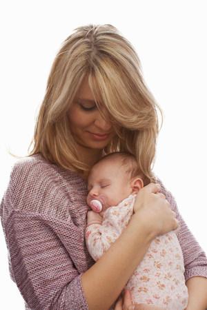 babys dummies: Mother holding newborn baby daughter