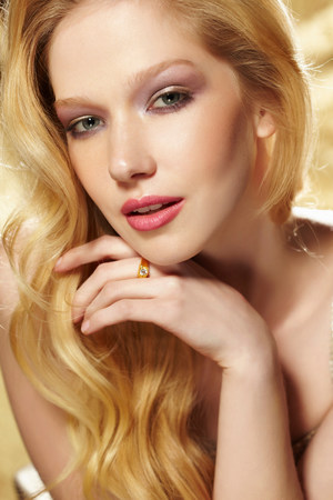 sultry: Studio portrait of young blond woman