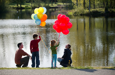 top 7: Family in front of lake with bunches of balloons