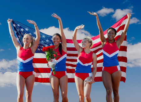 Four American athletes celebrating