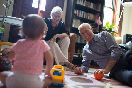 70 75: Toddler girl playing with grandparents