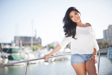 chillout: Portrait of young woman leaning on yacht railings,San Francisco,California,USA