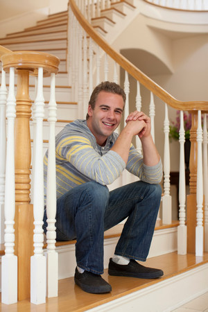 passageways: Young man sitting on stairs