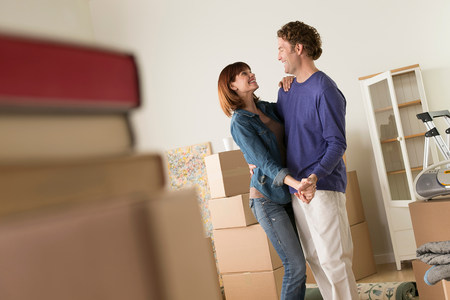 purples: Couple sharing dance whilst moving house