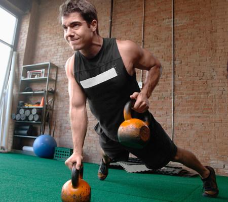 low self esteem: Male bodybuilder lifting kettlebells
