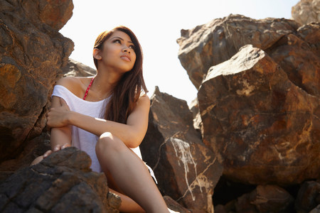 all under 18: Young woman in rocky shade,Palos Verdes,California,USA