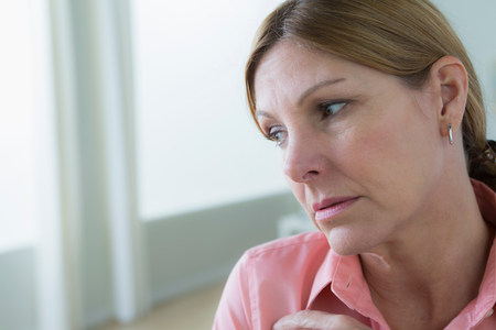 Portrait of sad mature woman looking away LANG_EVOIMAGES
