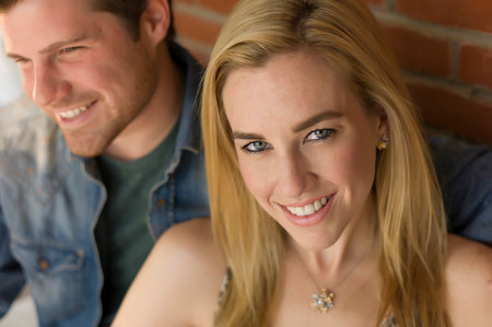 above 18: Portrait of couple,focus on young woman smiling