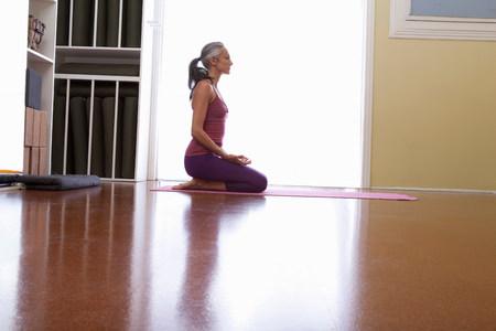Woman kneeling on floor