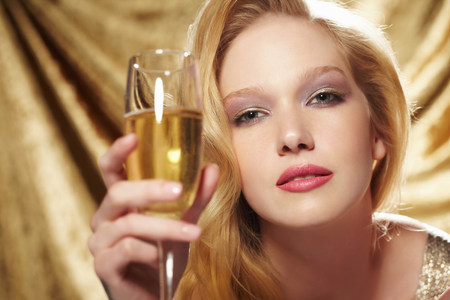 vintage: Portrait of young woman holding champagne flute