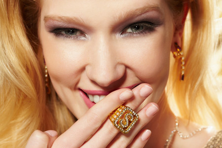sultry: Close up portrait of young woman wearing diamond signet ring