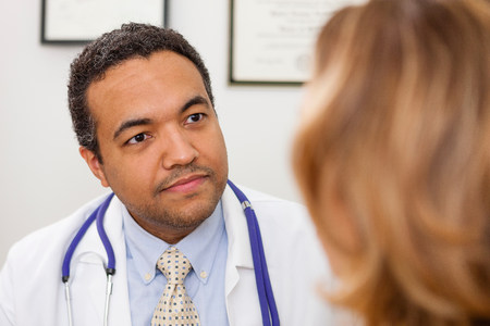Mature doctor listening to patient LANG_EVOIMAGES