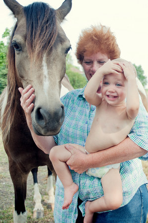 50 54 years: Grandmother and toddler with pony LANG_EVOIMAGES
