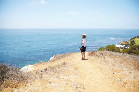 Young woman strolling at coast Palos Verdes,California,USA