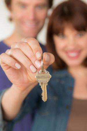 Couple holding new door key