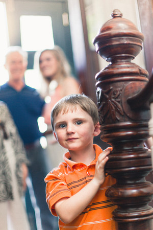 Portrait of boy by wooden banister
