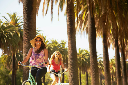 sultry: Women on bicycle laughing