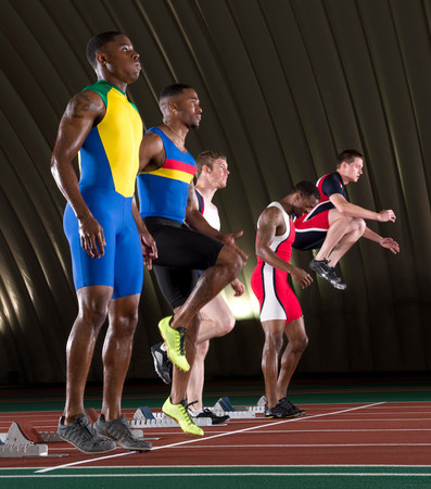 exerting: Athletes standing at start line of race LANG_EVOIMAGES