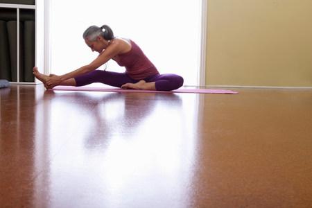 Woman stretching leg