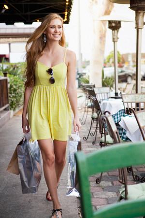 shopper: Woman shopper alongside pavement café