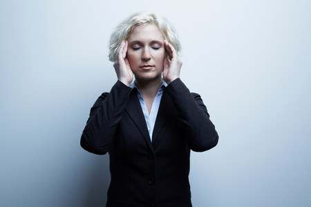 shutting: Studio portrait of businesswoman with hands on face LANG_EVOIMAGES